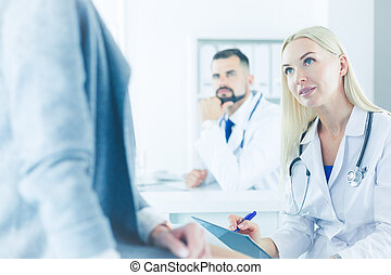 Successful medical doctors are sitting at the conference