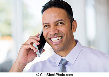 middle aged business man talking on cell phone