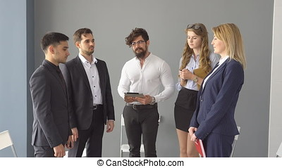 successful negotiations a completed with a handshake. a group of young businessman on business meeting