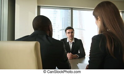Successful negotiations, job interview, businesspeople handshaking, signing papers on meeting