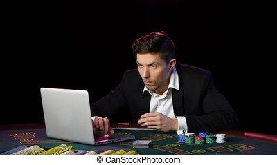 Successful online casino player winning. Close up