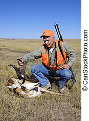 a pronghorn hunter with his quarry