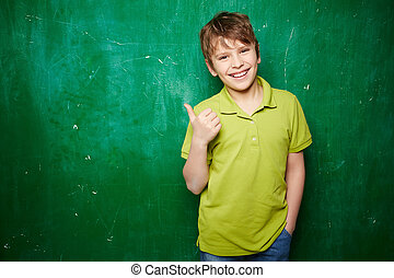 Successful schoolkid - Portrait of smiling schoolboy showing...