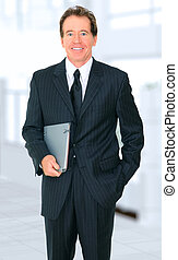 Successful Senior Businessman Holding Book