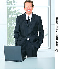Successful Senior Businessman In Office