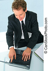 Successful Senior Businessman Working On His Laptop