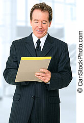Successful Senior Businessman Writing On Notepad