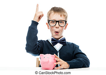 Successful small businessman with a piggy bank with the...