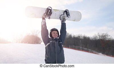 Successful Snowboarder Rising Snowboard in the Air -...