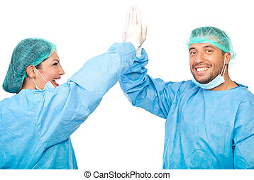 Successful surgery - Two surgeons giving high five after a ...