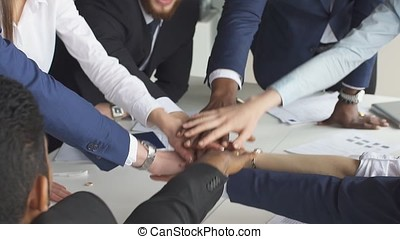 Successful team: many hands holding together, slow motion