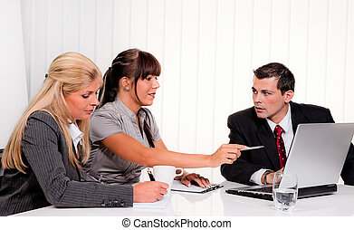 Successful Team - Successful young team at a meeting in the ...
