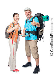 Successful travelers with backpacks on a white background in studio