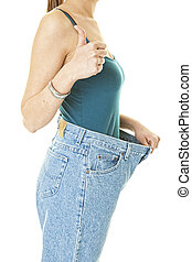 Successful Weight Loss - A woman showing off her dieting...