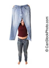Successful weightloss - Brunette holding up her old jeans...