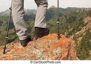 successful woman hiker hiking on mountain peak cliff