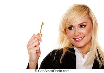 Successful woman holding brass key