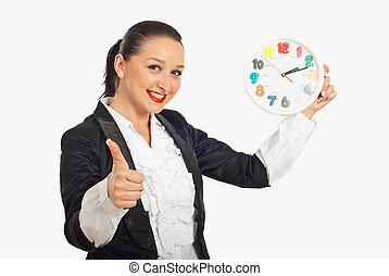 Successful woman holding clock