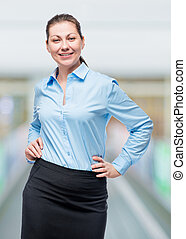successful woman in formal business clothes posing in office