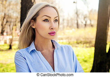 Successful woman, outdoors portrait