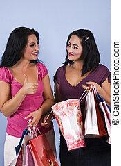 Successful women shopping