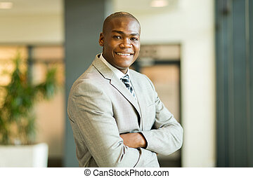young african office worker with arms crossed