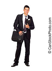Successful young business man carrying a briefcase and a folder
