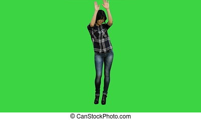 Successful young business woman happy for her success on a Green Screen, Chroma Key