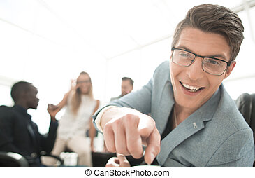 successful young businessman, pointing to you