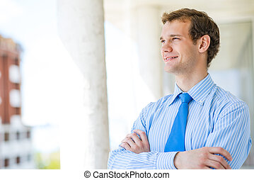 successful young businessman smiling