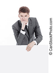 successful young businessman with blank banner.isolated on a white
