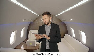 Successful young lawyer businessman is using tablet standing...