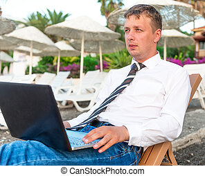 successful young man working on a holiday