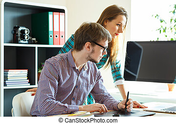 Successful young woman and man working from home