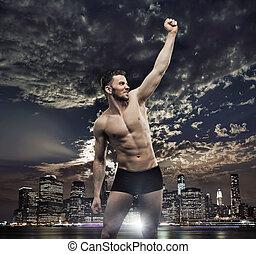 Successul man over the night city background