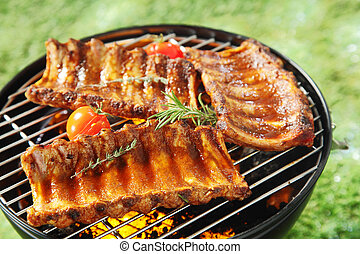 Succulent spicy spare ribs on a barbecue