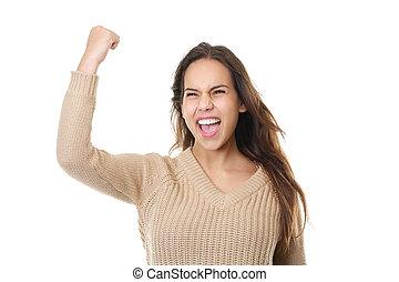 sucedido, mulher jovem, sorrindo, e, celebrando, com, punho, bomba