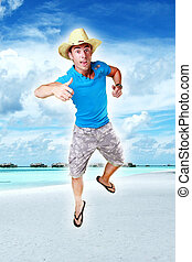 sucessfull man on the beach - Photograph of an energetic and...