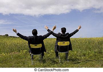 sucessfull partnership - two sucessful businessman enjoying...