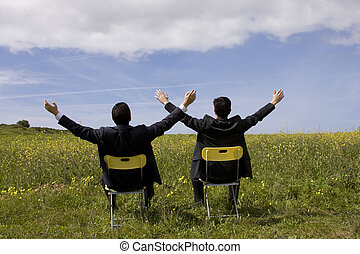 sucessfull partnership - two sucessful businessman enjoying ...
