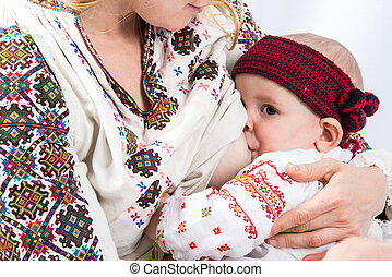 Mom breastfeeds the baby