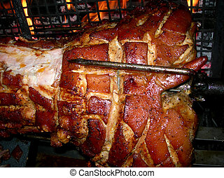 Suckling pig on a grill