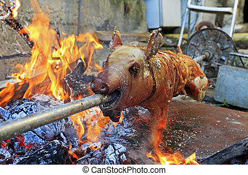 Suckling pig on a rotating spit