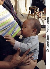 Suckling - Female ethnic (minority) Hmong black with her...