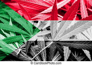 Sudan Flag on cannabis background. Drug policy. Legalization...