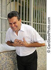 Man having a heart attack bending - Sudden chest pain: Man...