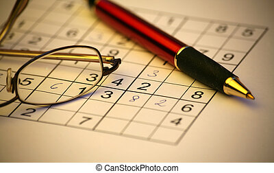 Sudoku with eyeglasses and pen