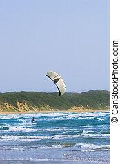 Sudwana #16 - A kite surfer surfing in Sudwana, South Africa