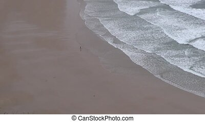 sufer walking at seashore 30 - surfer at beach in Asturias...