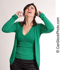 Suffering brunette talking with two phones